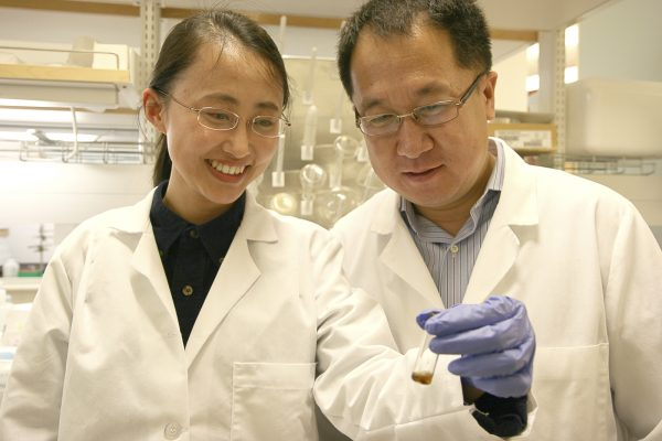 Dr. Jie Zheng (right), PhD - Associate Professor, Department of Chemistry and Biology