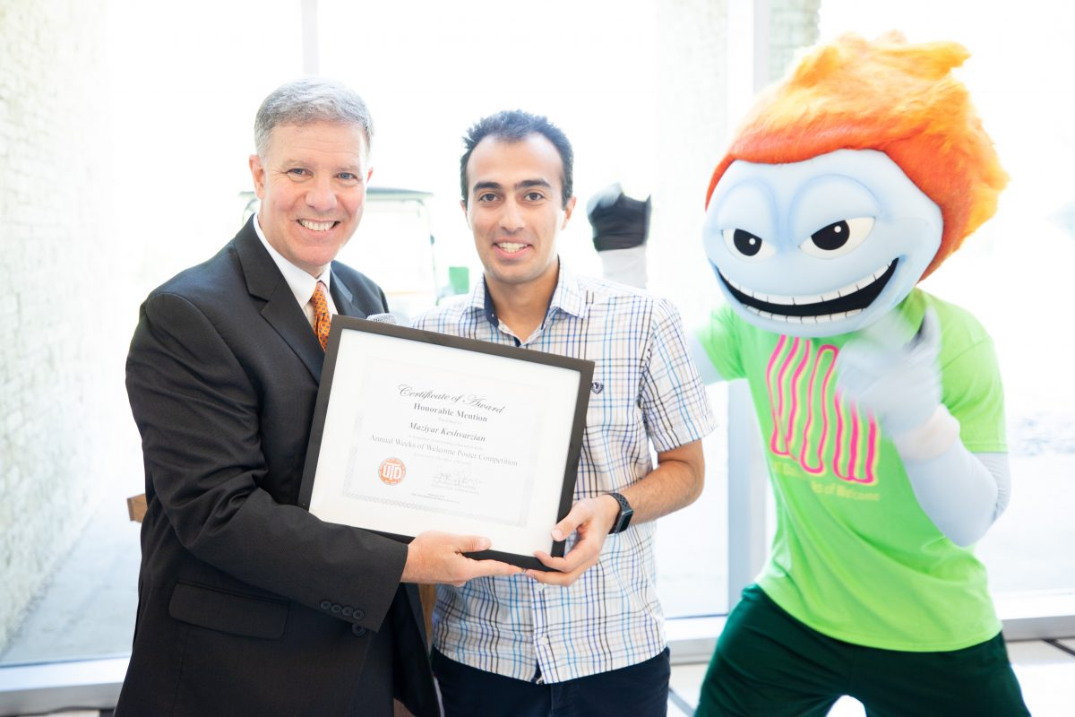 Photo bomb! Temoc shares his enthusiasm with Maziyar Keshavarzian, PhD candidate in bioengineering, on his achievement.