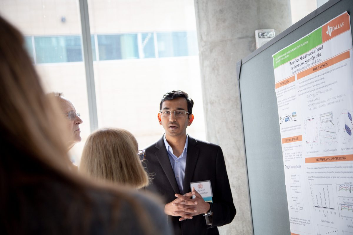 Vignesh Raghuraman, Research Assistant in Dr. Justin Koeln's lab, demonstrates his research to his audience.