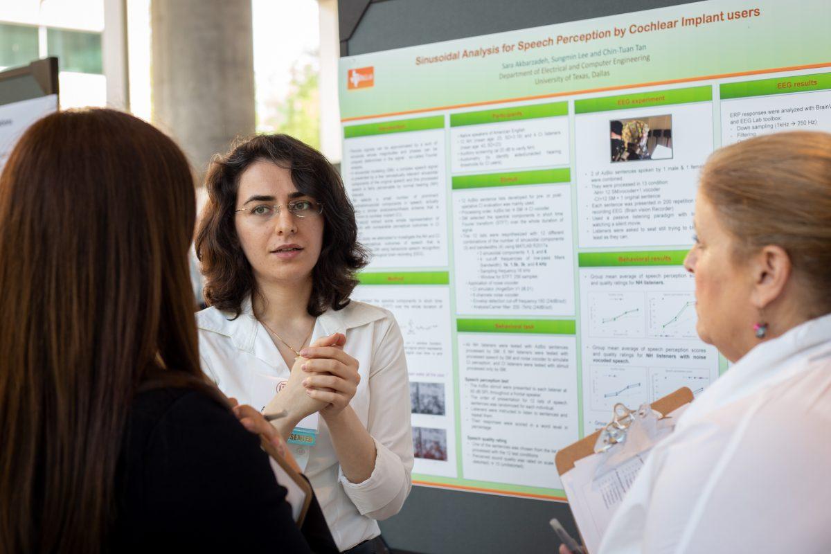 Sara Akbarzadeh, PhD candidate in Electrical Engineering, explains her research in speech perception to judges Tiffani Jantz-Fox and Alyssa Galganov.