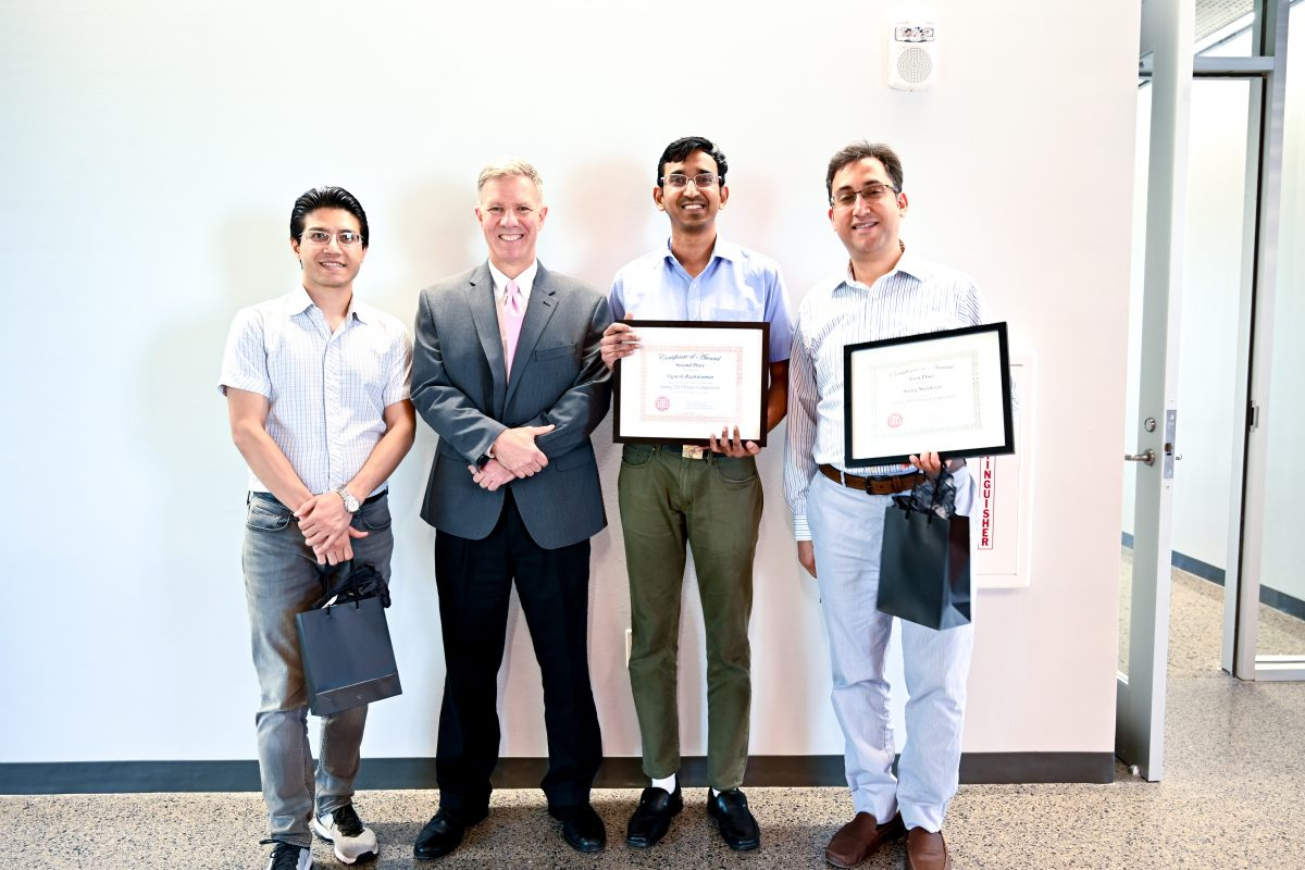 Dr. Joseph Pancrazio with (left to right) Jamasp Azarnoosh who received Honorable Mention, Second Place winner Vignesh Raghuraman, and First Place winner Sadeq Malakooti. Absent from picture, Baokun He in Third Place.
